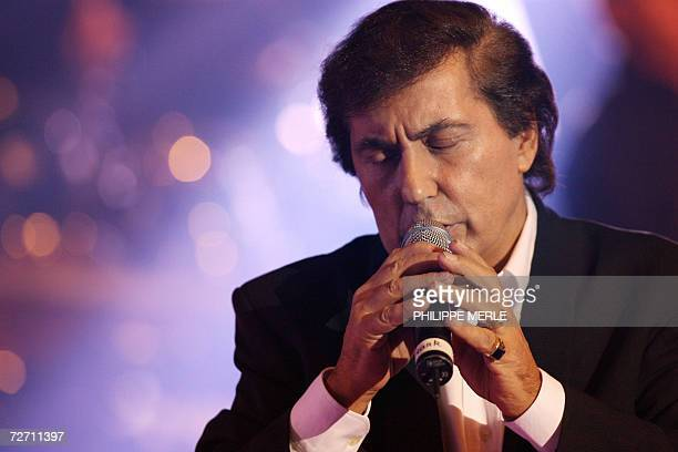 TO GO WITH AFP STORY IN FRENCH FRANK MICHAEL LE CHANTEUR DE CES DAMES French singer Frank Michael performs on the stage of the Parc des Expositions...