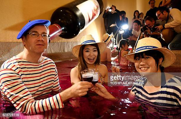 Bourgogne wine maker LaboureRoi Asia Pacific general manager Martin Romeijn toasts the company's 2016 Beaujolais Nouveau wine with guests at the wine...