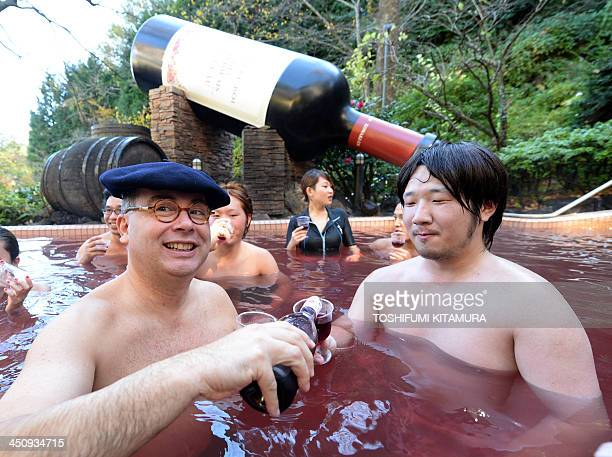 Bourgogne wine maker LaboureRoi vice president Thibault Garin offers the company's 2013 Beaujolais Nouveau wine to the guest in the wine spa at the...