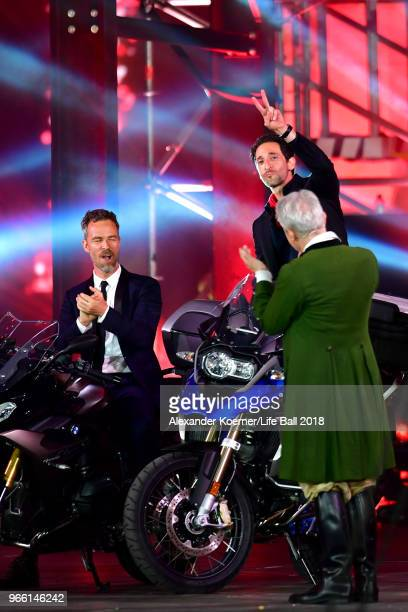 Bourne and Adrien Brody are seen on stage with their motorbikes during the Life Ball 2018 show at City Hall on June 2 2018 in Vienna Austria The Life...