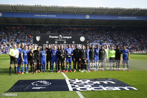 Bournemouth and Leicester City players pose in front of No Room For Racism banner before the Premier League match between Leicester City and AFC...