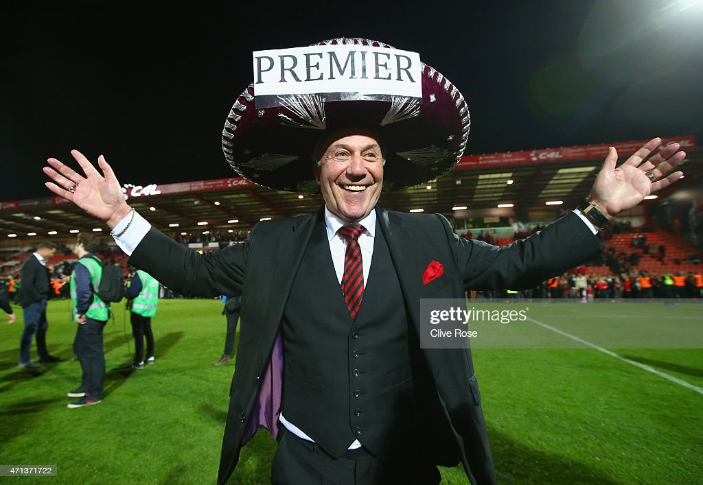 Bournemouth chairman Jeff Mostyn celebrates victory on the pitch after the Sky Bet Championship match between AFC Bournemouth and Bolton Wanderers at Goldsands Stadium on April 27, 2015 in Bournemouth, England. Bournemouth's 3-0 victory puts them on the brink of promotion to the Barclays Premier League.
