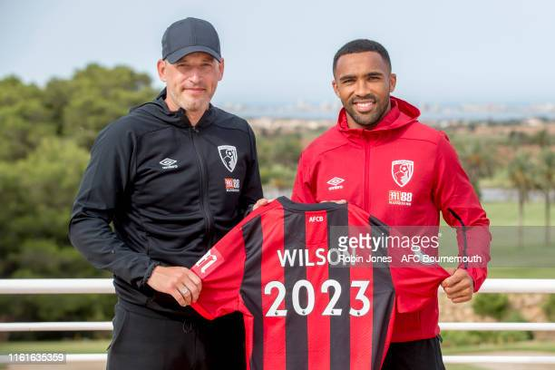 Bournemouth Chief Executive Neill Blake and Callum Wilson of Bournemouth, who has signed a new four year contract with the club till 2023, pose on...