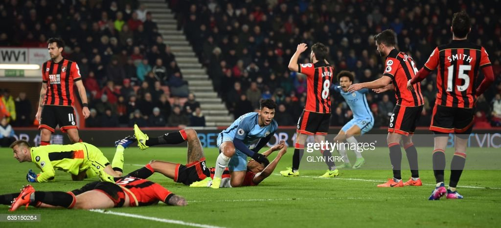 Bournemouth defenders react as Manchester City's Argentinian striker Sergio Aguero (C) celebrates after scoring their second goal during the English Premier League football match between Bournemouth and Manchester City at the Vitality Stadium in Bournemouth, southern England on February 13, 2017. / AFP / Glyn KIRK / RESTRICTED TO EDITORIAL USE. No use with unauthorized audio, video, data, fixture lists, club/league logos or 'live' services. Online in-match use limited to 75 images, no video emulation. No use in betting, games or single club/league/player publications. /