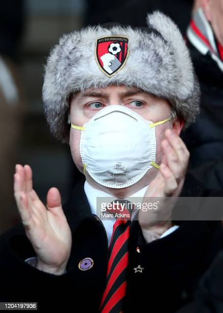 Bournemouth fan wear a facemask during the Premier League match between AFC Bournemouth and Chelsea FC at Vitality Stadium on February 29, 2020 in...