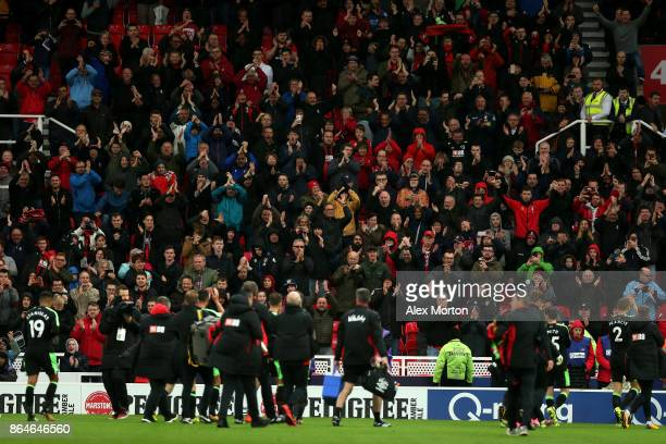 Bournemouth fans celebrate after the Premier League match between Stoke City and AFC Bournemouth at Bet365 Stadium on October 21 2017 in Stoke on...