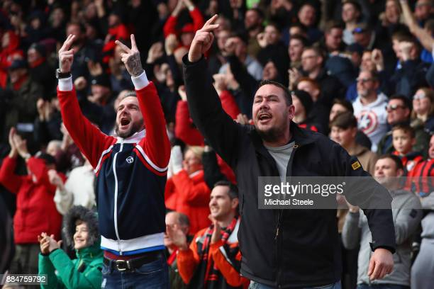 Bournemouth fans celebrate their sides first goal by gesturing towards Southampton fans during the Premier League match between AFC Bournemouth and...