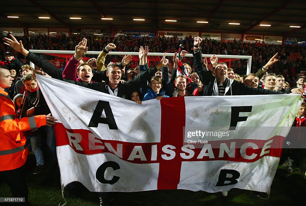Bournemouth fans celebrate victory on the pitch after the Sky Bet Championship match between AFC Bournemouth and Bolton Wanderers at Goldsands Stadium on April 27, 2015 in Bournemouth, England. Bournemouth's 3-0 victory puts them on the brink of promotion to the Barclays Premier League.