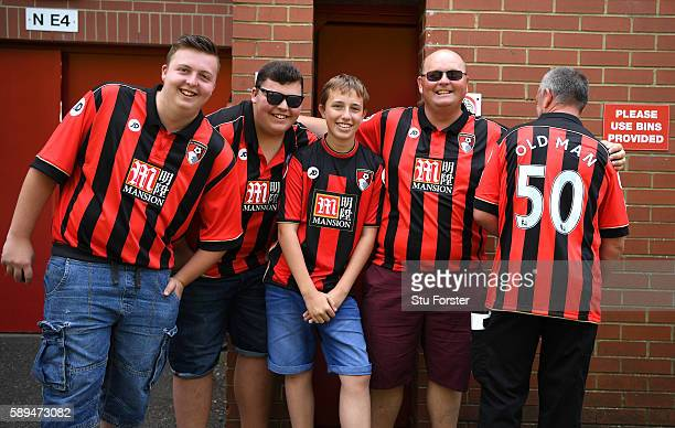 Bournemouth fans pose outside the ground prior to the Premier League match between AFC Bournemouth and Manchester United at Vitality Stadium on...