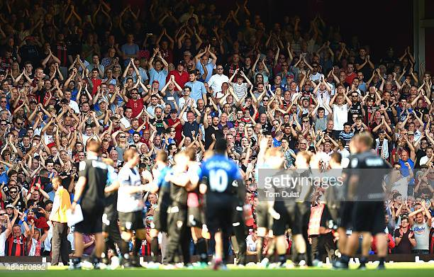 Bournemouth fans support their team after the Barclays Premier League match between West Ham United and Bournemouth at the Boleyn Ground on August 22...