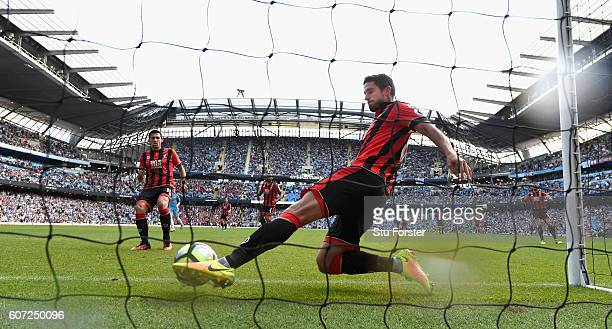 Bournemouth player Andrew Surman fails to stop the goal scored by Raheem Sterling during the Premier League match between Manchester City and AFC...
