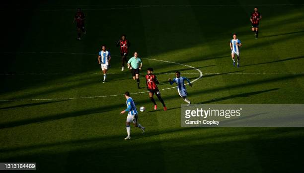 Bournemouth player Philip Billing makes a break through the Terriers midfield as the early evening sunshine casts it's shadows during the Sky Bet...