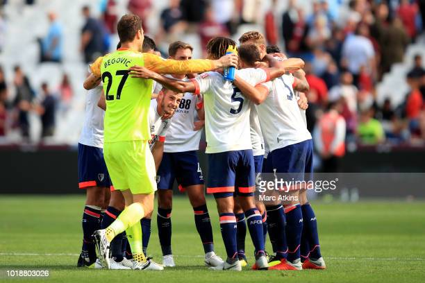 Bournemouth players celebrate at full time during the Premier League match between West Ham United and AFC Bournemouth at London Stadium on August 18...