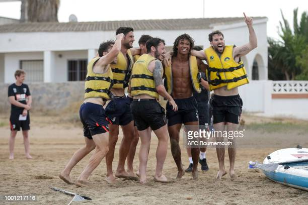 Bournemouth players celebrate during preseason teambuilding exercise on paddle boards on July 18 2018 in La Manga Spain
