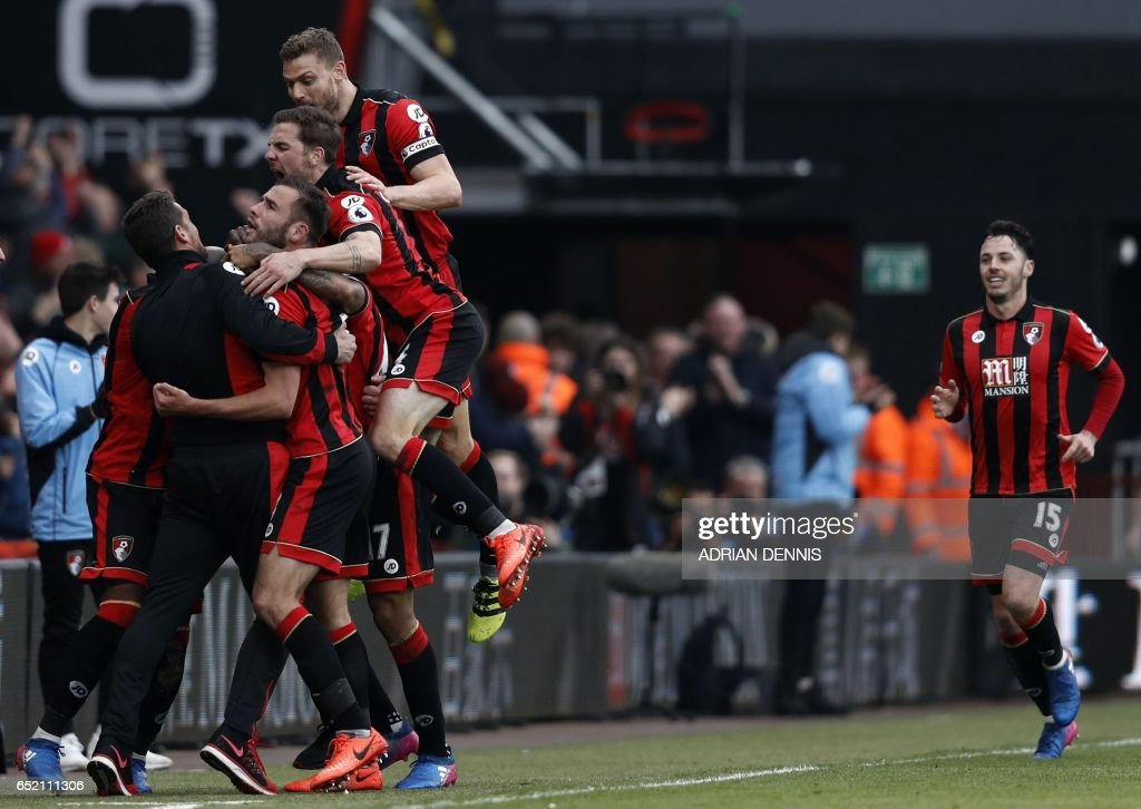 Bournemouth players celebrate on the touchline with manager Eddie Howe after Bournemouth's Norwegian striker Joshua King scores his third goal to give Bournemouth a 3-2 win in the English Premier League football match between Bournemouth and West Ham United at the Vitality Stadium in Bournemouth, southern England on March 11, 2017. Bournemouth won the game 3-2. / AFP PHOTO / Adrian DENNIS / RESTRICTED TO EDITORIAL USE. No use with unauthorized audio, video, data, fixture lists, club/league logos or 'live' services. Online in-match use limited to 75 images, no video emulation. No use in betting, games or single club/league/player publications. /