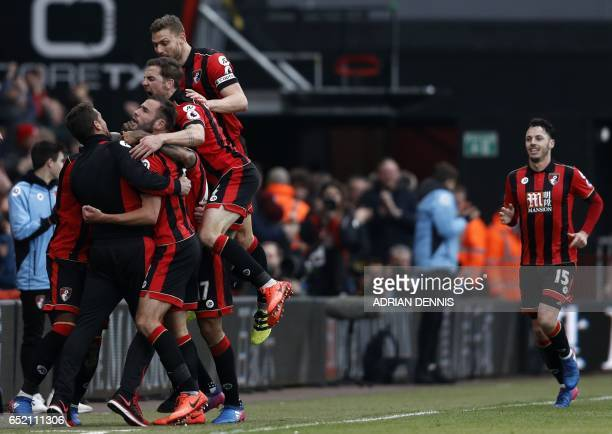 Bournemouth players celebrate on the touchline with manager Eddie Howe after Bournemouth's Norwegian striker Joshua King scores his third goal to...