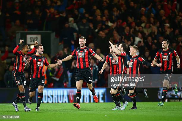 Bournemouth players celebrate their team's first goal during the Barclays Premier League match between AFC Bournemouth and Manchester United at...