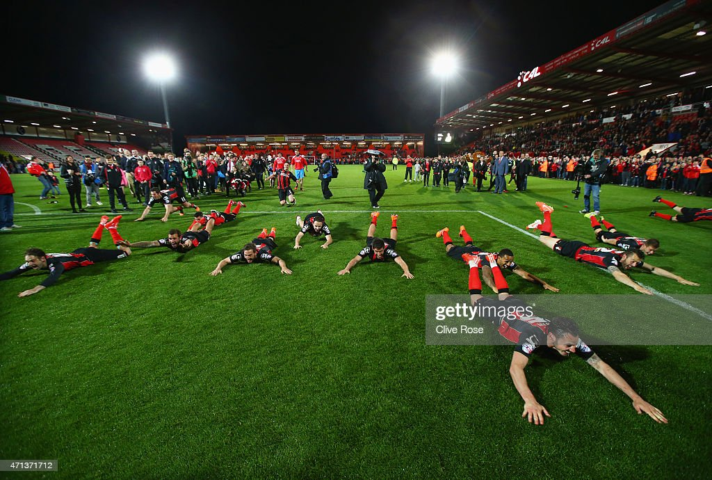 Bournemouth players celebrate victory on the pitch after the Sky Bet Championship match between AFC Bournemouth and Bolton Wanderers at Goldsands Stadium on April 27, 2015 in Bournemouth, England. Bournemouth's 3-0 victory puts them on the brink of promotion to the Barclays Premier League.