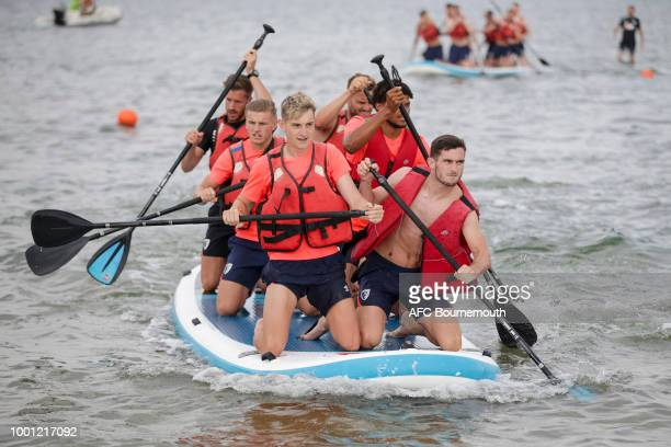 Bournemouth players David Brooks and Lewis Cook lead the way on paddle boards during preseason teambuilding exercise on July 18 2018 in La Manga Spain