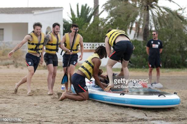 Bournemouth players Harry Arter Adam Smith and Nathan Ake congratulate teammate Jordon Ibe during preseason teambuilding exercise on July 18 2018 in...