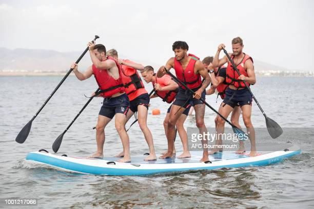 Bournemouth players Lewis Cook Tyrone Mings and Simon Francis lead the way on paddle boards during preseason teambuilding exercise on July 18 2018 in...