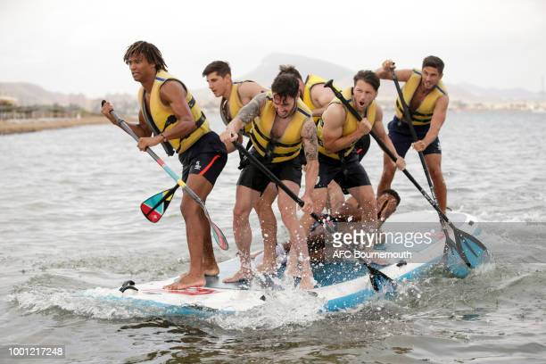 Bournemouth players Nathan Ake Adam Smith and Harry Arter take to paddle boards during preseason teambuilding exercise on July 18 2018 in La Manga...