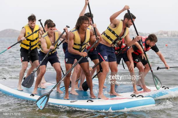 Nathan Ake Adam Smith and Harry Arter of Bournemouth lead the way during preseason teambuilding exercise involving paddle boards on July 18 2018 in...