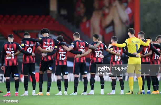 Bournemouth players observe a minutes silence in memory of former England player Nobby Stiles MBE and to mark Armistice Day prior to the Sky Bet...
