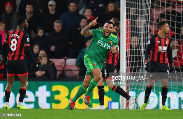 Bournemouth players react as Troy Deeney of Watford celebrates as he scores his team's first goal during the Premier League match between AFC...
