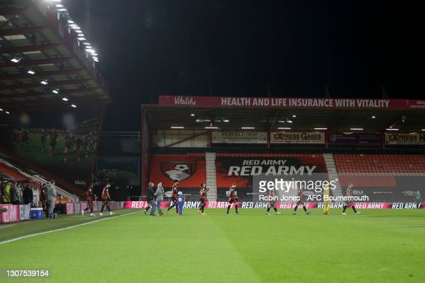 Bournemouth players walk out to empty stadium during the Sky Bet Championship match between AFC Bournemouth and Swansea City at Vitality Stadium on...
