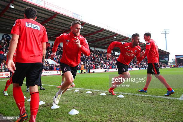 Bournemouth players warm up during the FA Cup Fourth Round match between Bournemouth and Liverpool at Goldsands Stadium on January 25 2014 in...