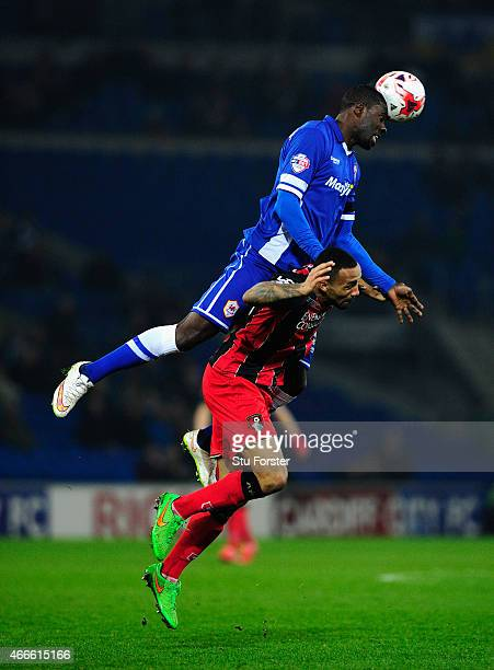 Bournemouth striker Callum Wilson is outjumped by Cardiff defender Bruno Ecuele - Manga during the Sky Bet Championship match between Cardiff City...