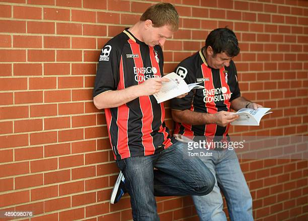 Bournemouth supporters read mathday programmes prior to the Barclays Premier League match between AFC Bournemouth and Sunderland at Vitality Stadium...