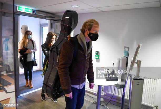 Bournemouth Symphony Orchestra members have their temperature checked on arrival on February 23, 2021 in Poole, England. Bournemouth Symphony...