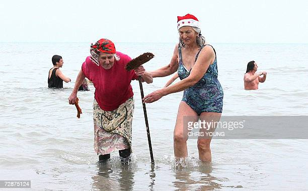 Members of the Bournemouth Spartans swimming club take to the English Channel for their Christmas Day swim in Boscombe Bournemouth Dorset 25 December...