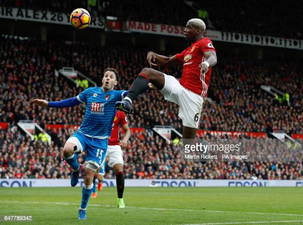 AFC Bournemouth's Adam Smith and Manchester United's Paul Pogba in action during the Premier League match at Old Trafford Manchester