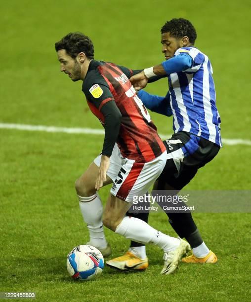Bournemouth's Adam Smith shields the ball from Sheffield Wednesday's Kadeem Harris during the Sky Bet Championship match between Sheffield Wednesday...