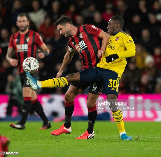 Bournemouth's Andrew Surman vies for possession with Arsenal's Eddie Nketiah during the FA Cup Fourth Round match between Bournemouth and Arsenal at...
