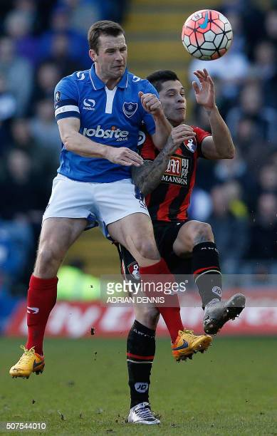 Bournemouth's Argentinian midfielder Juan Iturbe vies with Portsmouth's Irish midfielder Michael Doyle during the English FA Cup fourth round...
