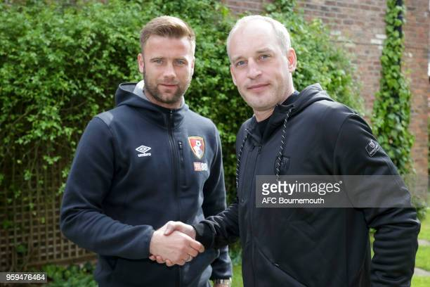 Bournemouth's Artur Boruc shakes hands with the club's chief executive Neill Blake after signing a 1 year extension to his current contract on May 12...