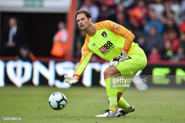 Bournemouth's BosnianHerzegovinian goalkeeper Asmir Begovic rolls out the ball during the English Premier League football match between Bournemouth...