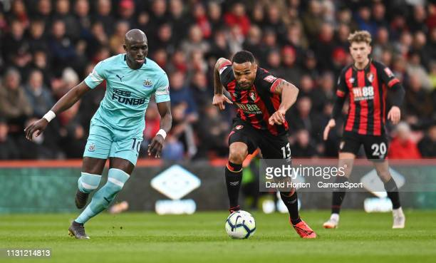 Bournemouth's Callum Wilson under pressure from Newcastle United's Mohamed Diame during the Premier League match between AFC Bournemouth and...