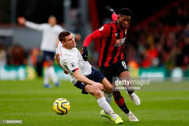 Bournemouth's Colombian midfielder Jefferson Lerma challenges Liverpool's English midfielder James Milner during the English Premier League football...