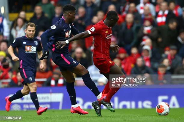 Bournemouth's Colombian midfielder Jefferson Lerma tackles Liverpool's Senegalese striker Sadio Mane during the English Premier League football match...