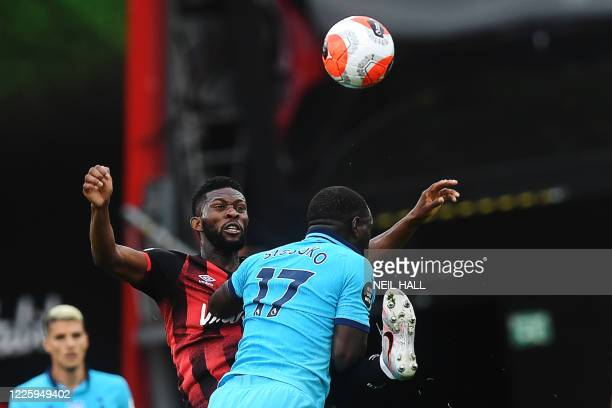 Bournemouth's Colombian midfielder Jefferson Lerma vies for the ball with Tottenham Hotspur's French midfielder Moussa Sissoko during the English...