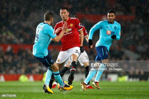 AFC Bournemouth's Dan Gosling and Manchester United's Nemanja Matic battle for the ball during the Premier League match at Old Trafford Manchester