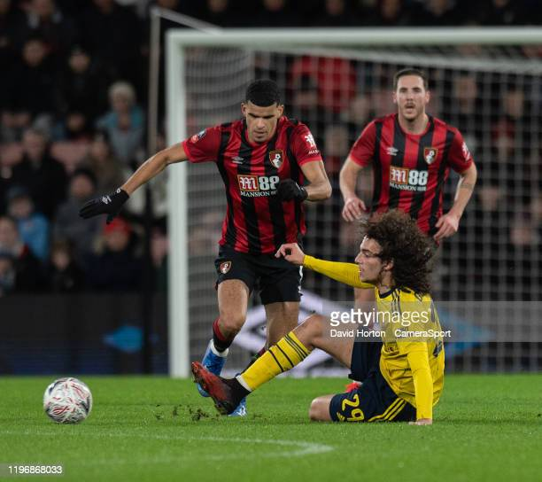 Bournemouth's Dominic Solanke battles for possession with Arsenal's Matteo Guendouzi during the FA Cup Fourth Round match between Bournemouth and...