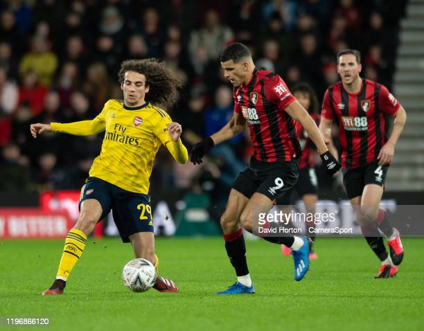 Bournemouth's Dominic Solanke battles with Arsenal's Matteo Guendouzi during the FA Cup Fourth Round match between Bournemouth and Arsenal at...