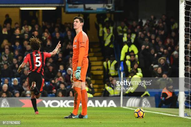 Bournemouth's Dutch defender Nathan Ake celebrates scoring the team's third goal past Chelsea's Belgian goalkeeper Thibaut Courtois during the...