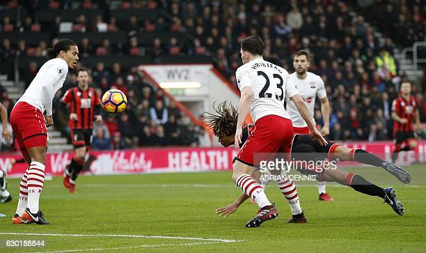 Bournemouth's Dutch defender Nathan Ake dives to head the ball and scores his team's first goal during the English Premier League football match...